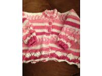 Baby's hand knitted cardigan