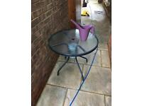 Blue metal / glass top garden table