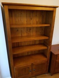 Solid dark wood dresser wall unit with four shelves and a cupboard