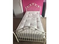 White metal bed frame with heart detail