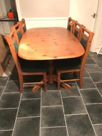 Solid oak extending dining table & 6 matching chairs