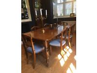 Solid wood antique extendable dining table and 10 chairs