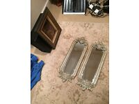 A pair of antique style silver colour mirrors