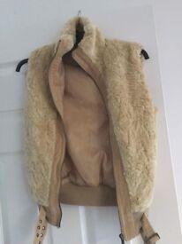Cream fur gilet size 10