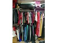 loads of woman's clothes all different sizes