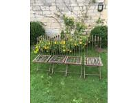 Antique wrought iron garden chairs.