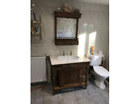 Bathroom Vanity Unit with Sink. It has a Marble top and comes with a mirror and corner shelf unit