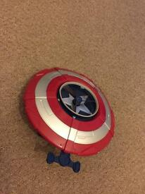 Captain America shield whith flying saucer in the middle