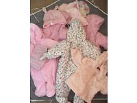 Two bags of baby girl clothes ages 0 -9 months