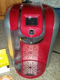 Keurig coffee maker with accessories.
