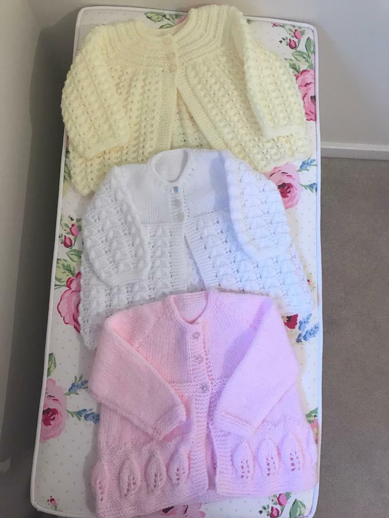 3 Hand knitted baby girl cardigans