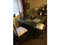 Glass top black iron dinning table 4 chairs