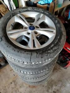 215 55 16 Continental 100% tread allseason tires on OEM 2015 Ford Focus Alloy rims 5 x 108 / TPMS -- $800