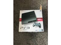 Black Boxed PlayStation 3 320gb with control and 19 games