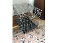 SAVIC make metal folding dog's cage with plastic tray base.