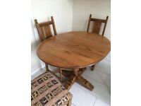 """Medium oak """"old charm"""" dining table and 4 chairs bought Leeks. Excellent condition. Table extends."""