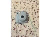 Fujifilm instax Polaroid camera blue