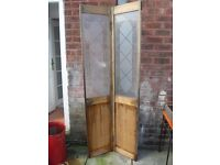 Pine folding door with glass panels