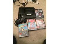 Megadrive console and games aga