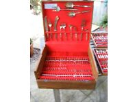 144 piece Stainless Nickel Bronze cutlery set in wooden box.
