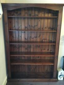 Dark stained pine colonial bookcase