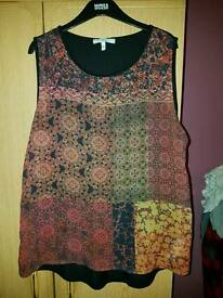 Sleeveless top out of new look