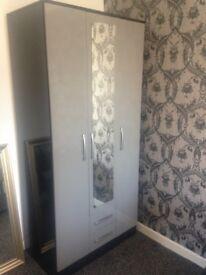 Black/ grey gloss 3 door 2 draw wardrobes. Excellent condition