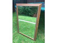 Dark pine ornate framed mirror