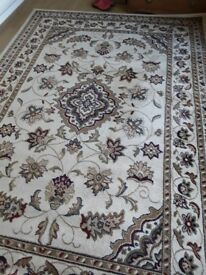 Large patterned rug / carpet. Beige with other colours