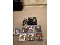 Playstation 4 500gb black slim with two controllers and 6 game and a blu ray dvd