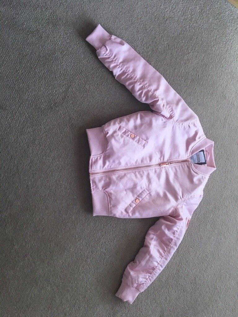 Girls pink almost new bomber jacket