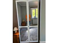 Two door wardrobe + chest of drawers (with mirror). Bedroom set or sold separately