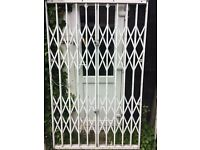 HEAVY DUTY SECURITY GATE, FOR INSIDE USE OR OUTSIDE.