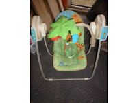 FISHER PRICE baby swing chair with activity bar great amusement
