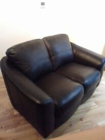Lovely 2 seater sofa - faux black leather - hardly used