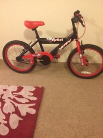 "Huffy Rebel boys bike 18"", excellent condition."