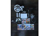 Wii With games and Guitar Hero Excellent Condition