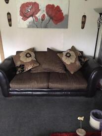 Brown three piece couch