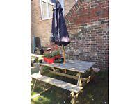 Garden bench picnic style with umbrella