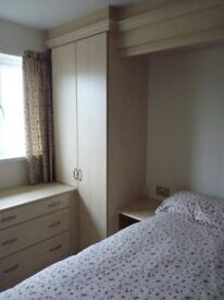 Double and single fitted wardrobe with over bed plinth