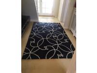 Black and cream rug