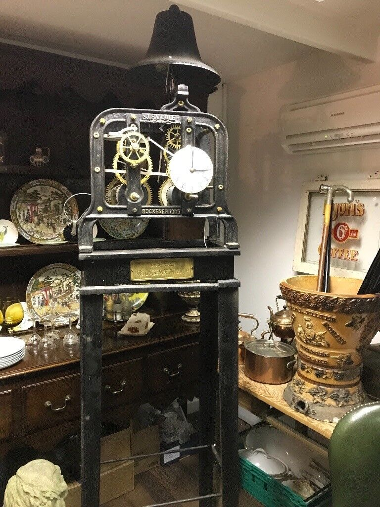 Large turret clock. Complete with stand, weights, pendulum and crank key.