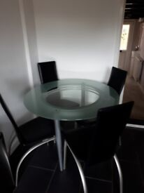 Glass Round Top Table plus 4 Italian Leather Dining Chairs