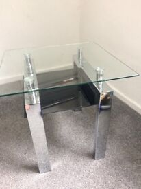 Two matching glass side tables
