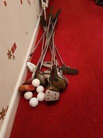 Assorted golf clubs and golf balls