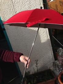 Red pram umbrella