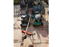 Two petrol lawnmowers and petrol strimmer