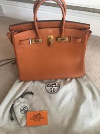 Hermes like orange bag.