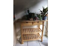 Wooden butchers block style Kitchen Unit, two drawers, two shelves and thick wood top.