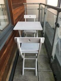 Small outdoor vintage table and chairs